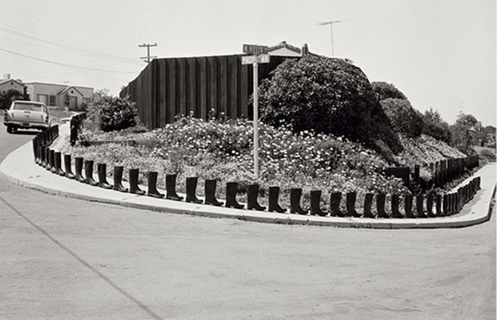 Eleanor Antin black and white photograph of 100 Boots Turn the Corner