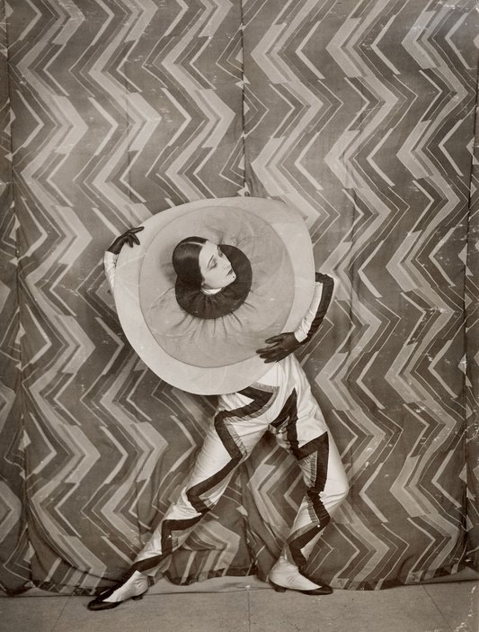 wearing the Pierrot-Éclair costume designed by Sonia Delaunay, on the set of René Le Somptier's film Le P'tit Parigot 1926
