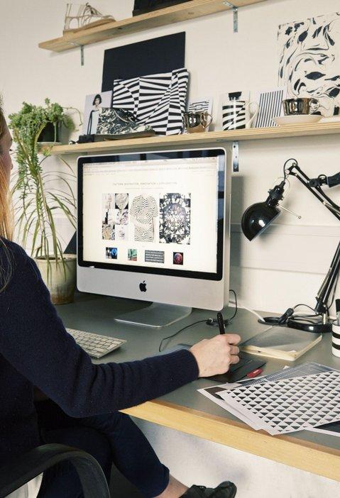 Grace Winteringham at work on mac in Patternity studio