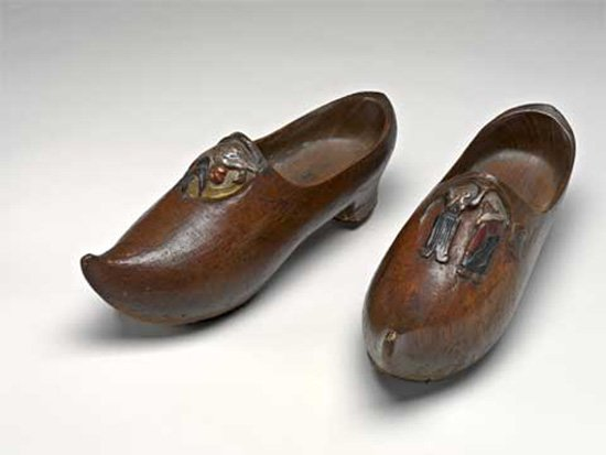 a pair of wooden clogs carved by Gauguin