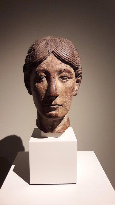 A carved head, possibly from a reliquary bust, French, second half of 12th century