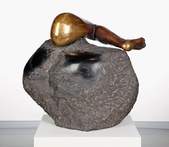 Alina Szapocznikow leg 1965 bronze leg embedded in a round lump of granite rock