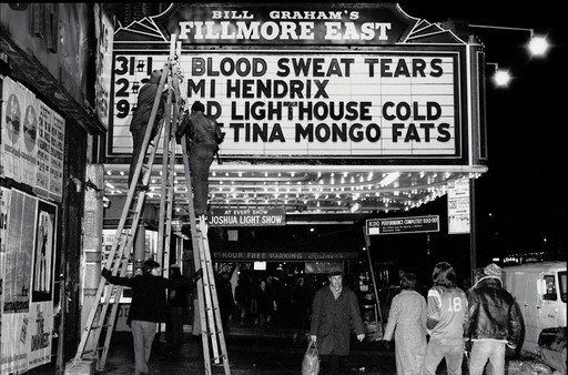 Amalie R Rothschild Changing the Fillmore East signs at the end of the Blood Sweat and Tears show 28 December 1969