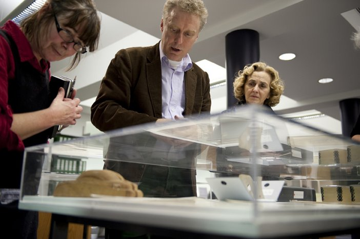 Visitors explore material from Tate's archive as part of a learning event