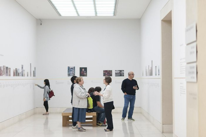 Archive Explorer in conversation with visitors in Tate Britain gallery