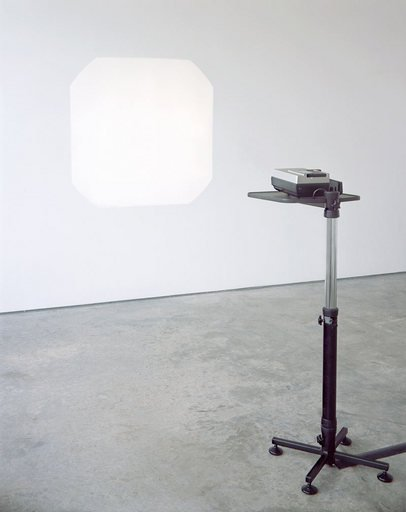 Ceal Floyer Auto Focus 2002 a photograph of a projector machine projecting a white square on to a white gallery wall