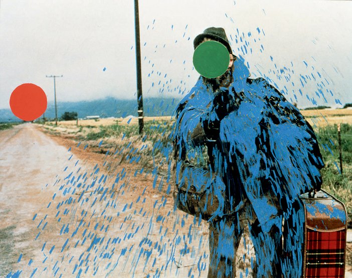 John Baldessari Hitch hiker Splattered Blue 1995 a photograph of a man at the side of a dirt road with a green dot covering the hitch hikers face added to the photo along with blue paint splatters