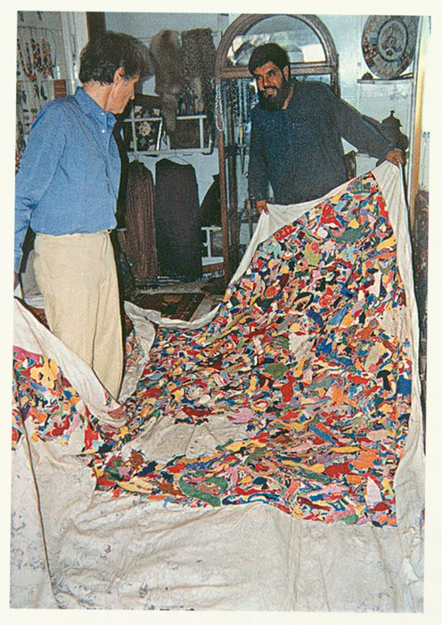 Boetti inspecting the production of a Tutto (Everything) embroidery in Peshawar, 1989