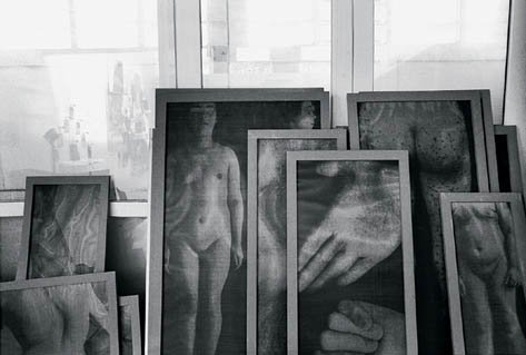 Christian Boltanski, many works against window in studio
