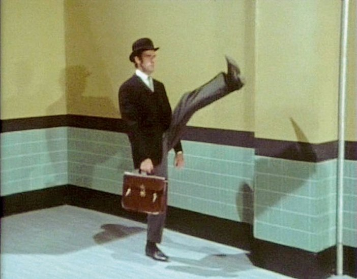 John Cleese in Monty Python Ministry of Silly Walks sketch