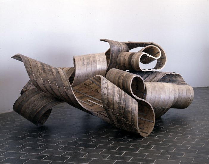 Richard Deacon Restless 2005 showing a twisted wood floor sculpture by the artist