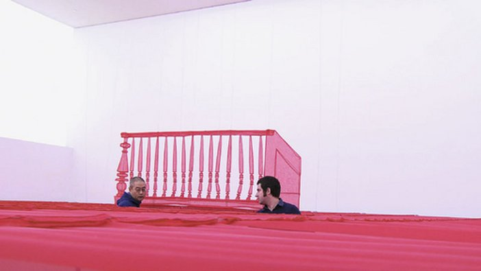Film still of Do Ho Sugh (left) installing Staircase - III at Tate Modern, March 2011