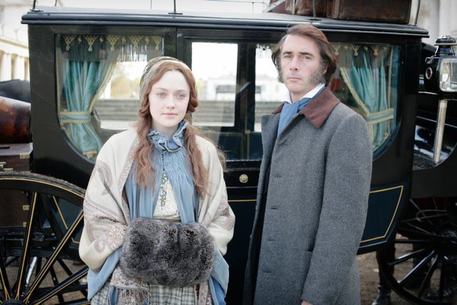 Dakota Fanning as Effie Gray and Greg Wise as John Ruskin