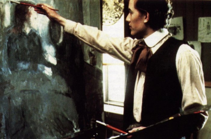 Still from Peter Watkins's film Edvard Munch showing the painter at work