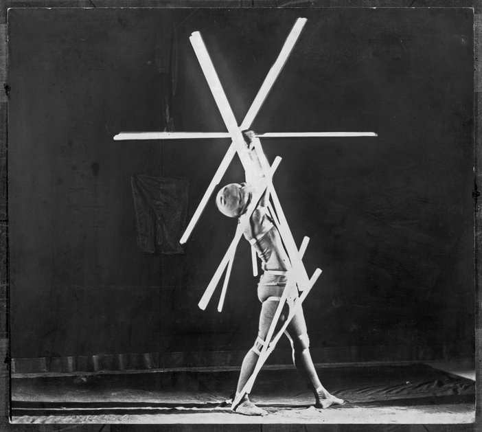A dancer poses during Oskar Schlemmer's Stick Dance, part of his Triadic Ballet 1926–9 (reproduced in 1980)