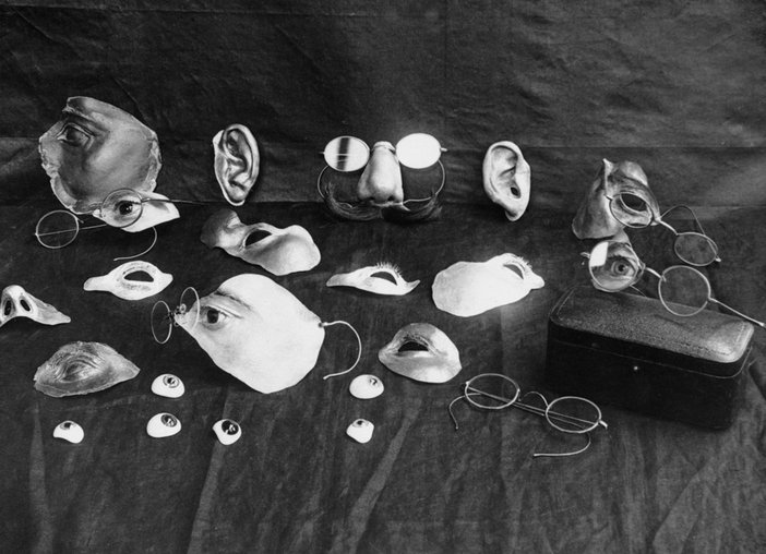 Selection of items used to disguise facial injury during the First World War and early development of plastic surgery; the original caption reads: 'Repairing war's ravages: renovating facial injuries', c1914–8
