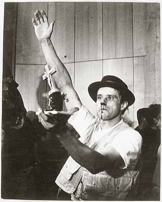 Joseph Beuys photographed during performance at Fluxus Festival of New Art, Aachen, 20 July 1964