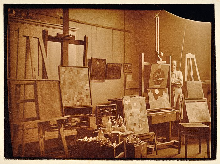 Paul Klee in his studio at Weimar Bauhaus, photographed by Felix Klee, 1925