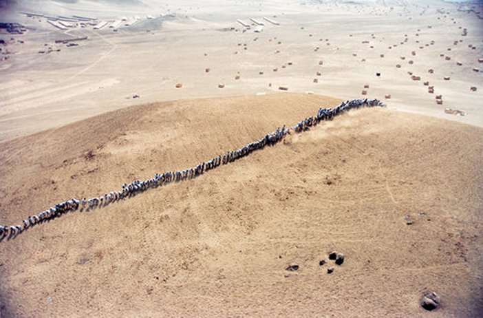 Video still from Francis Alyss When Faith Moves Mountains documentation of an action near Lima Peru 2002