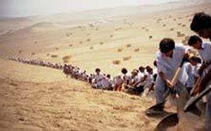 Francis Alys When Faith Moves Mountains 2002 Video still