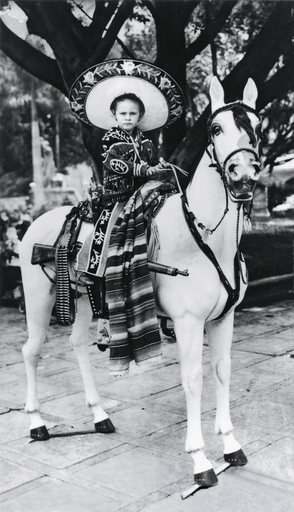 Gabriel Orozco aged four in Cuernavaca Morelos Mexico1966 black and white photograph of a little boy in traditional Mexican dress sat on a horse
