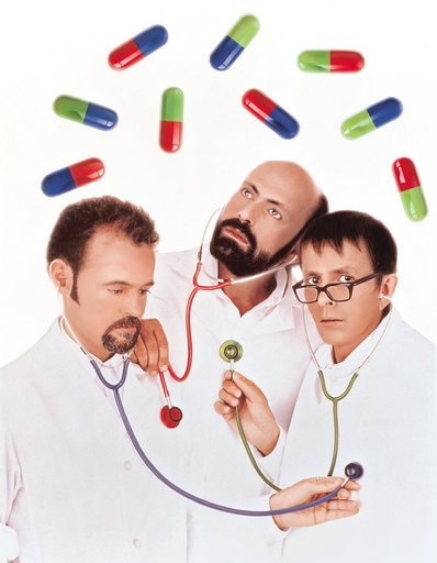 General Idea Playing Doctor 1992 three men dressed as doctors with stethoscopes in their ears listening to each others heart beat there are over sized pills floating above them