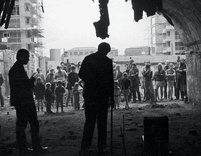Gilbert and George performing Singing Sculpture, Cable Street, London, 1969