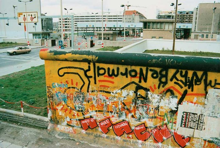 Lost Art: Keith Haring - section of Berlin Wall mural covered by graffiti