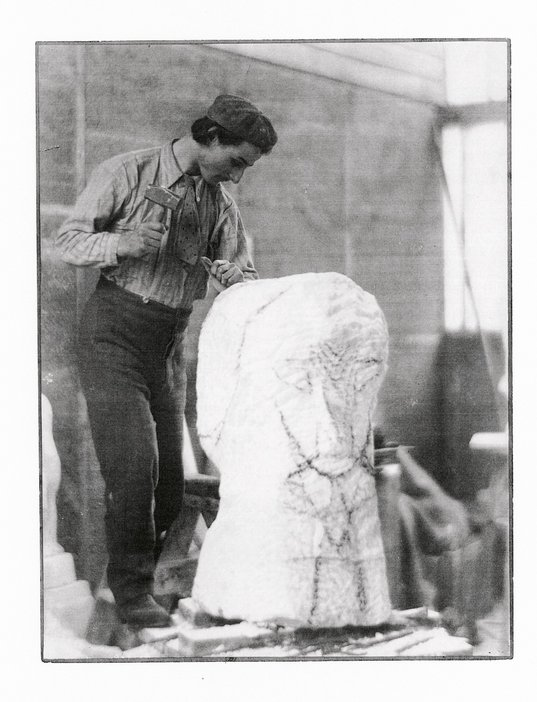 Henri Gaudier Brzeska carving Hieratic Head of Ezra Pound c1914 photograph of a man carving a peice of white marble