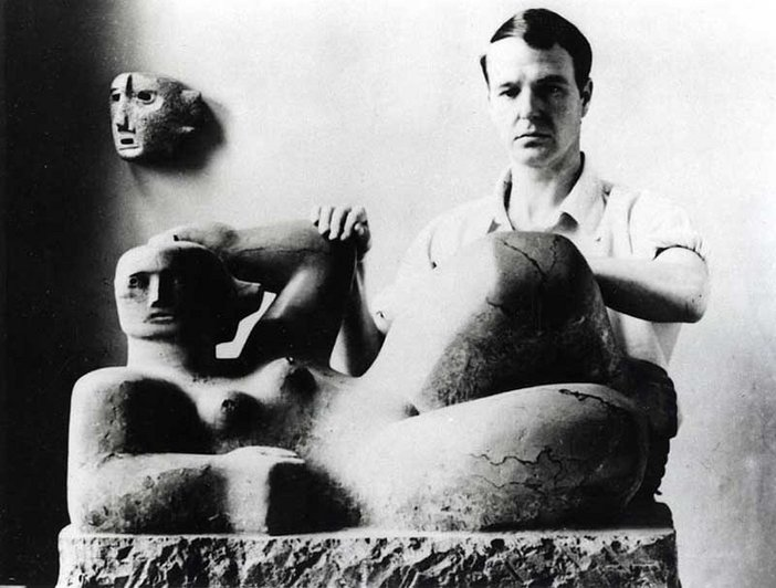 Photograph showing Henry Moore with his sculpture Reclining Figure and Mask