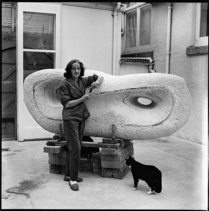 Barbara Hepworth with her cat Nicholas and Curved Reclining Form (Rosewall) 1960–2