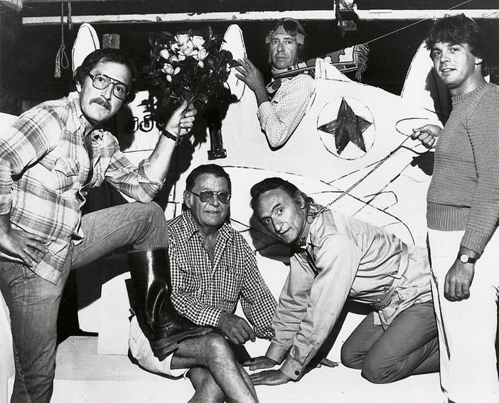 Howard Kanovitz Kyle Morris Larry Rivers Donald Sanders and Kenneth Koch in a plane prepare for Kochs play The Red Robins at the Guild Halls John Drew Theatre in Southampton New York 1977