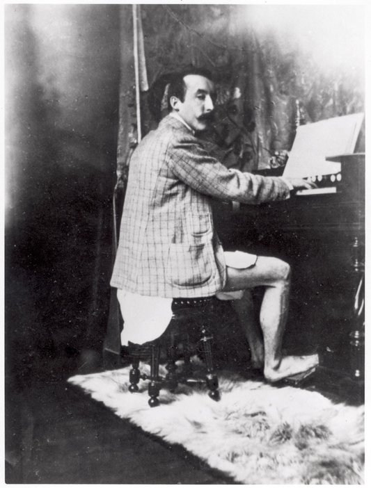 Photograph, said to be of Paul Gauguin playing the harmonium, taken by Alphonse Marie Mucha in his studio (1895)