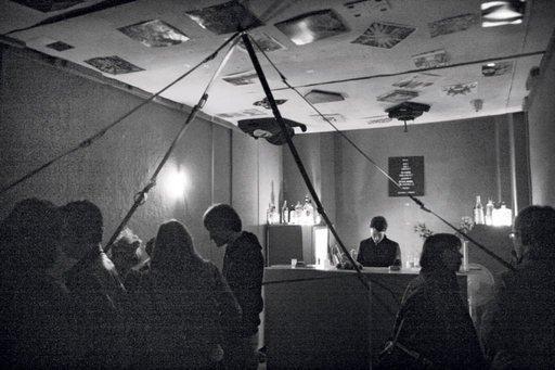 Inside Galerie Im Regierungsviertels Forgotten Bar Berlin photograph an interior filled with people and a bar with a bar tender