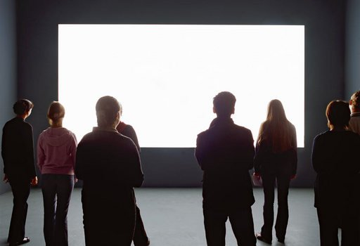 Installation view of Alredo Jaars Lament of the Images 2002 at the Louisiana Museum of Modern Art visitors watching a projection of a white rectangle in a gallery