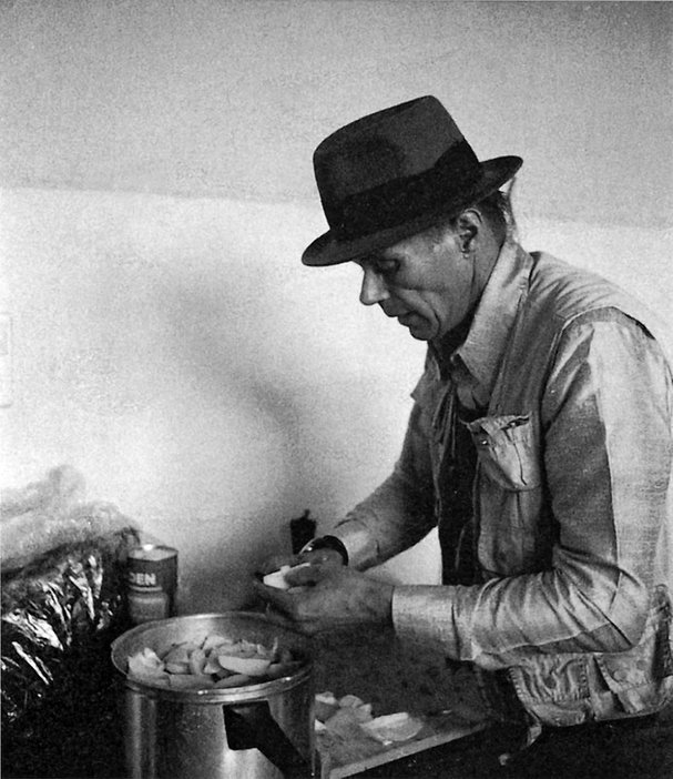 Joseph Beuys cooking stew in his Dusseldorf studio 1984