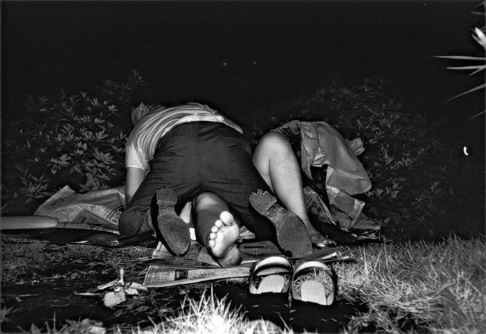 Kohei Yoshiyuki Untitled from the series the park photograph of a man lying on top of a woman amongst bushes
