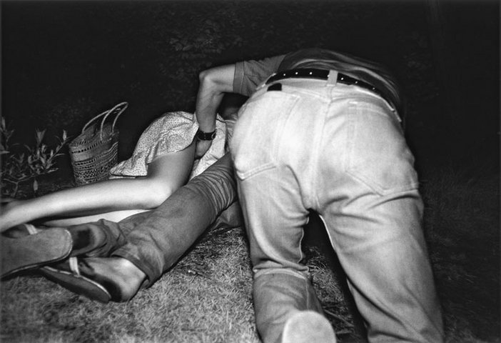 Kohei Yoshiyuki Untitled from the series the park 1971 to 1979 men and women writhing around on the grass
