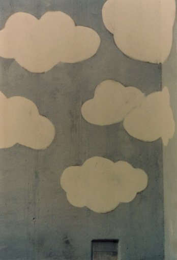 Luigi Ghirri Lucerna from Fotografie del periodo iniziale 1971 c print of building exterior with blue sky and white clouds painted on it