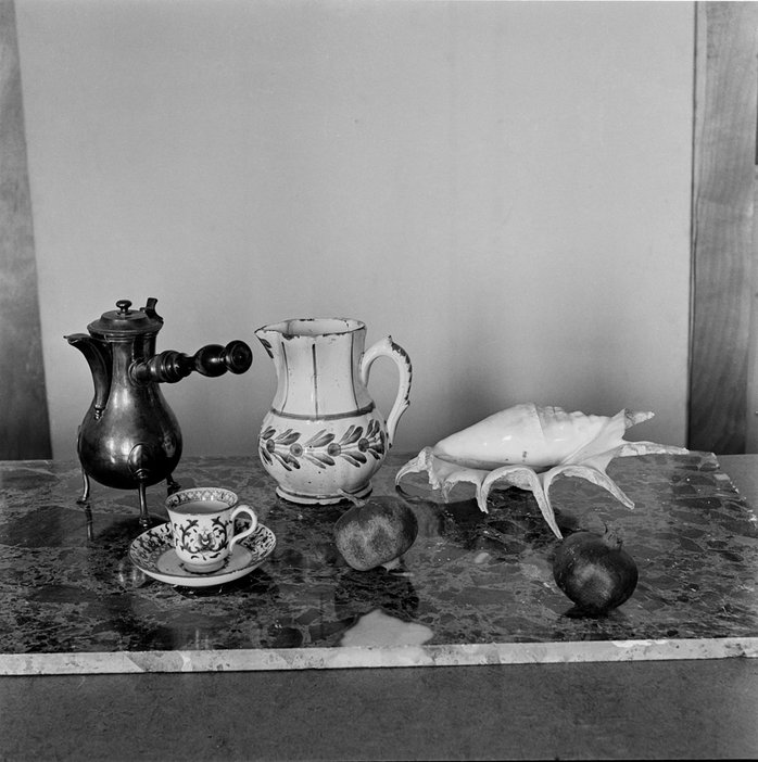 Items from Matisse's collection arranged in a still life, including the chocolatière (far left) and pomegranates Centre Pompidou