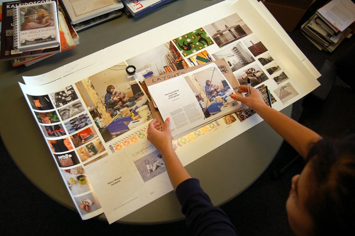 Mariko assesing layouts for issue 30, Spring 2014 of Tate ETC. magazine
