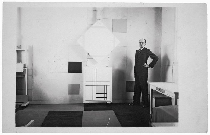 Mondrian in his Paris studio in 1933 with Lozenge Composition with Four Yellow Lines