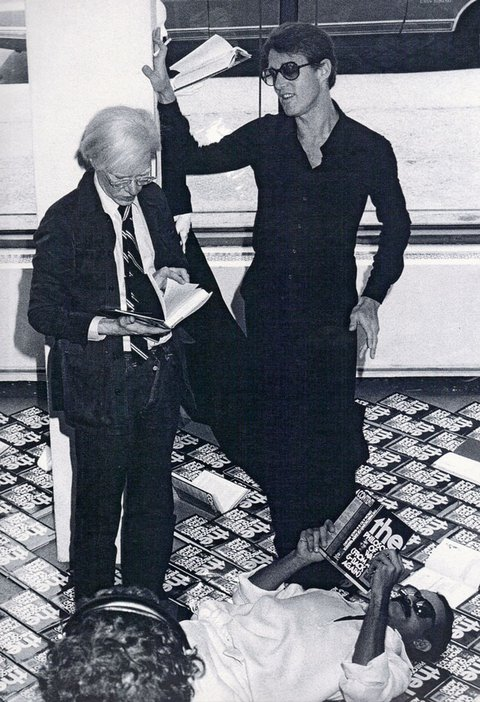 Andy Warhol with Halston in a window display for his book 'The Philosophy of Andy Warhol (From A to B and Back Again)', 1975