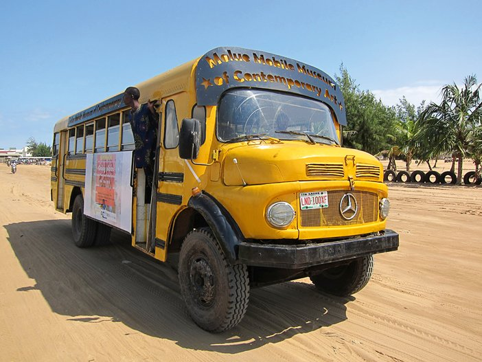 Emeka Udemba's Molue Mobile Museum of Contemporary Art, driving on the beach in Cotonou, Benin, 2014