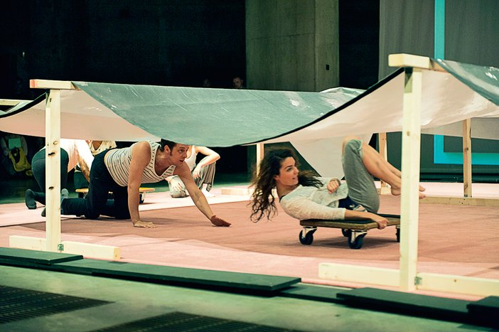 Rolling underneath a reproduction of Jutta Koether's painting La Femme, 2006 during Ei Arakawa's Kissing the Canvas performance