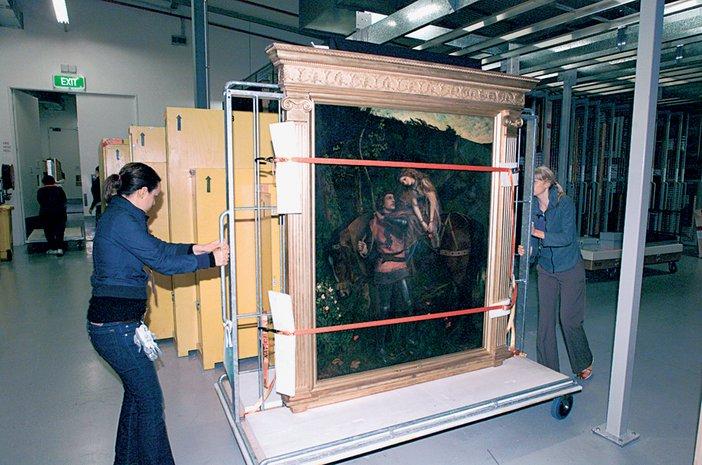 National Gallery of Victoria, Melbourne, art handlers moving Arthur Hughes's La Belle Dame Sans Merci 1861–3