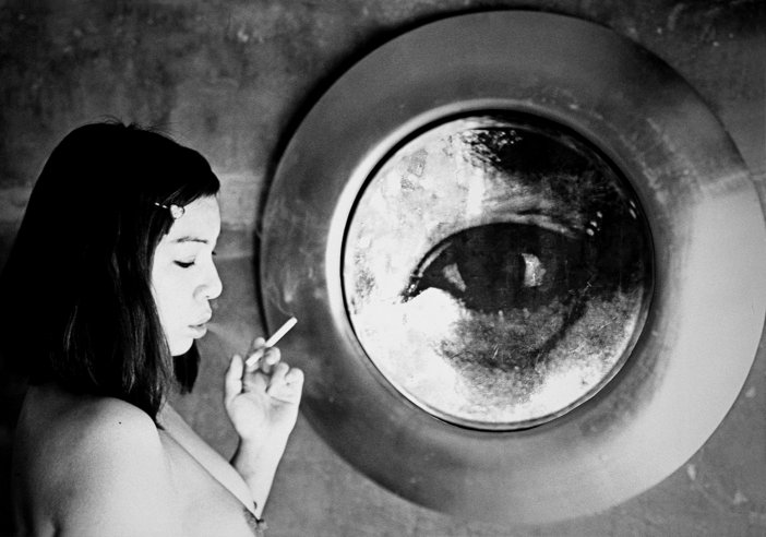 Tokyo Rumando girl smoking side of mirror reflecting large eye Tokyo Rumando