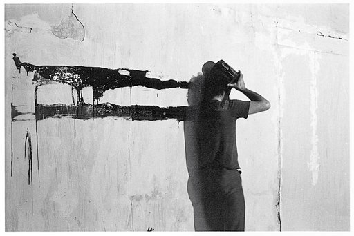 Paul McCarthy Face Head Shoulder Painting Wall Black Line 1972 photograph of a man dragging paint across a wall with his head face and shoulder