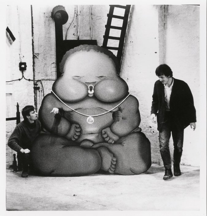 Per Kirkeby and Bjorn Norgaard with Jorg Immendorffs Fotonegerchen Aachen Germany 1967 two men stood next to a cardboard cut out of a large baby
