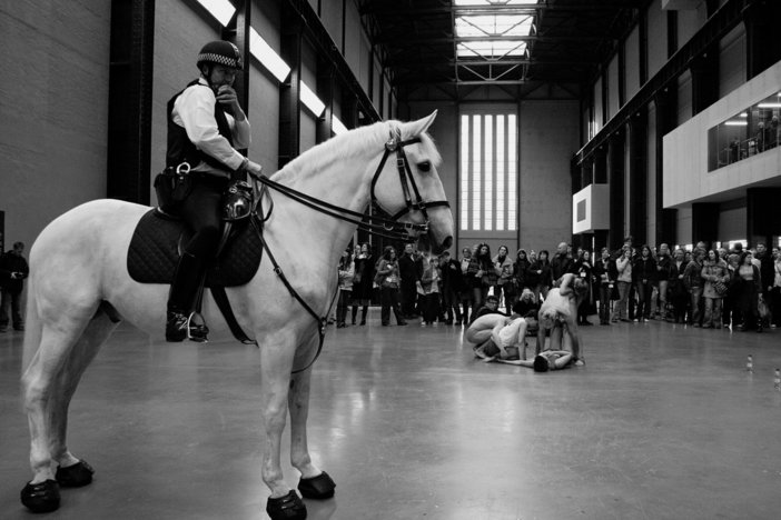 Performance of Tania Bruguera's Tatlin's Whisper #5 in the Turbine Hall at Tate Modern 2008